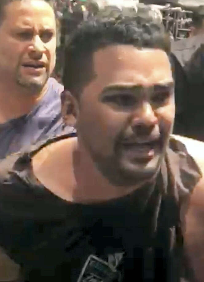 In this image made from video provided by Oscar Navarro Reyes, Richard Rojas is arrested after a fatal automobile accident on New York City's Times Square, Thursday, May 18, 2017. Authorities and witnesses said Rojas drove his car the wrong way up a Times Square street and plowed into pedestrians on the sidewalk. Photo: Oscar Navarro Reyes Via AP    / Oscar Navarro Reyes