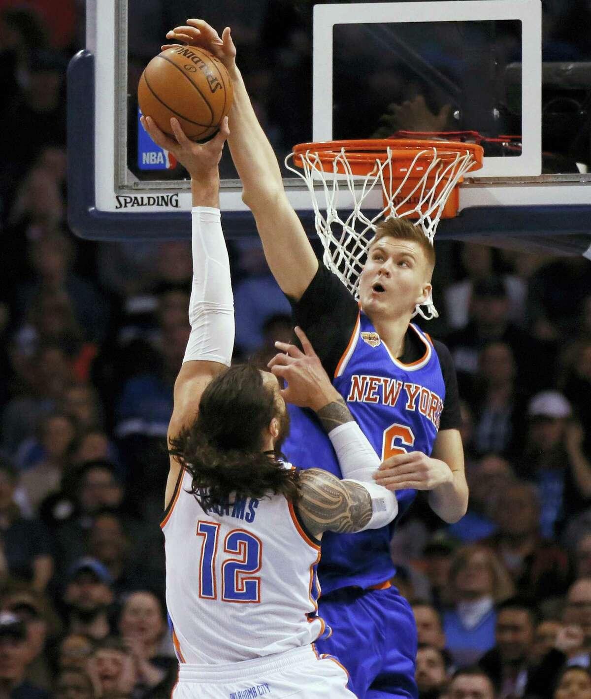 New York Knicks forward Kristaps Porzingis (6) blocks a shot by Oklahoma City Thunder's Steven Adams during the first quarter of an NBA basketball game in Oklahoma City on Feb. 15, 2017.