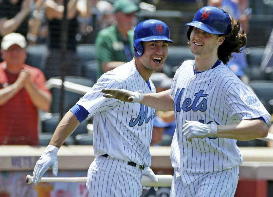 The Mets' Michael Conforto, left, congratulates starting pitcher Jacob deGrom, who hit a home run in the third inning on Sunday. Photo: Kathy Willens — The Associated Press   / Copyright 2017 The Associated Press. All rights reserved.