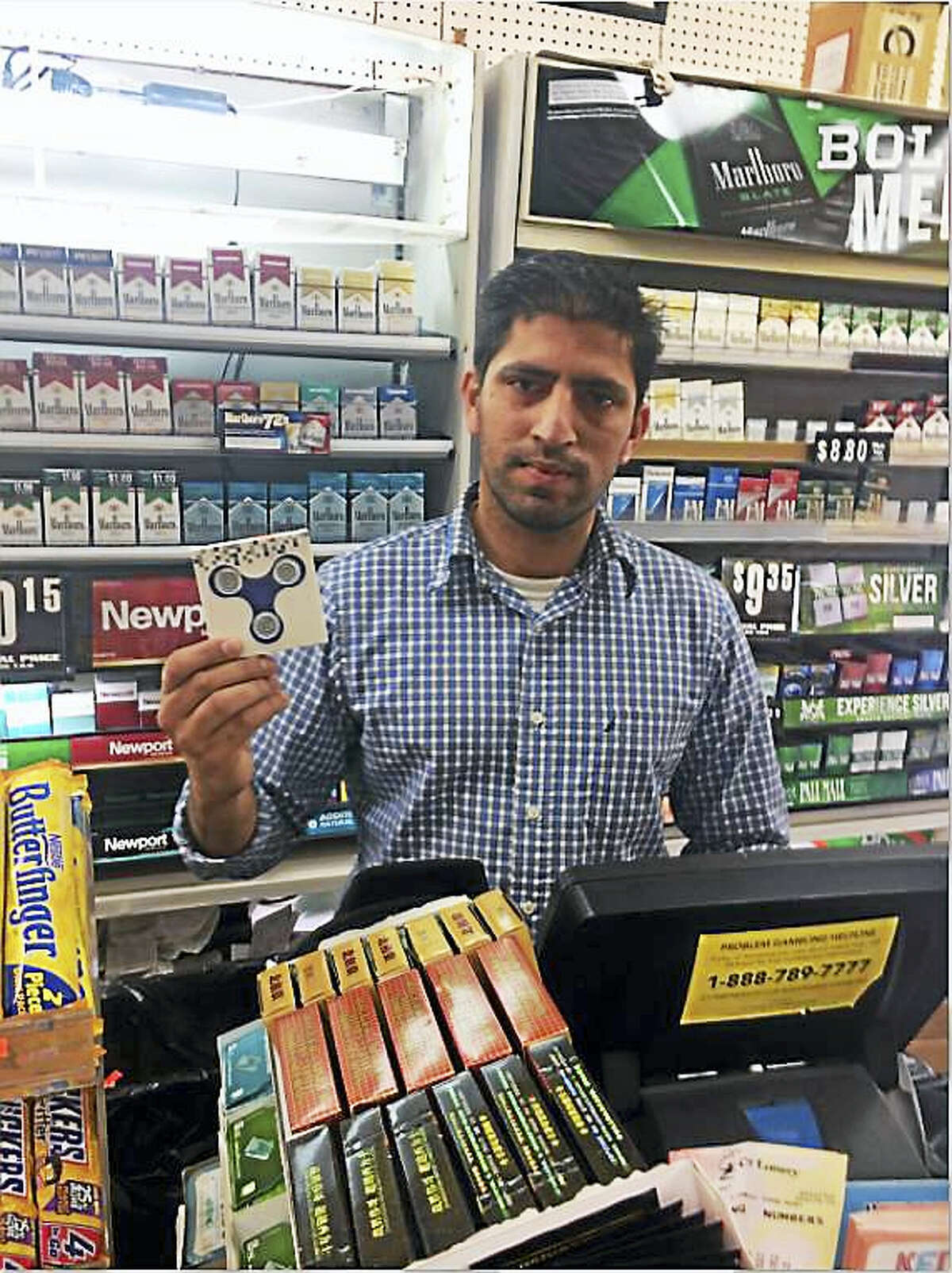 "Syed ""Seth"" Naqshband, manager at the Shell Food Mart on Willow Street in New Haven, said their supply of fidgets sells out quickly"