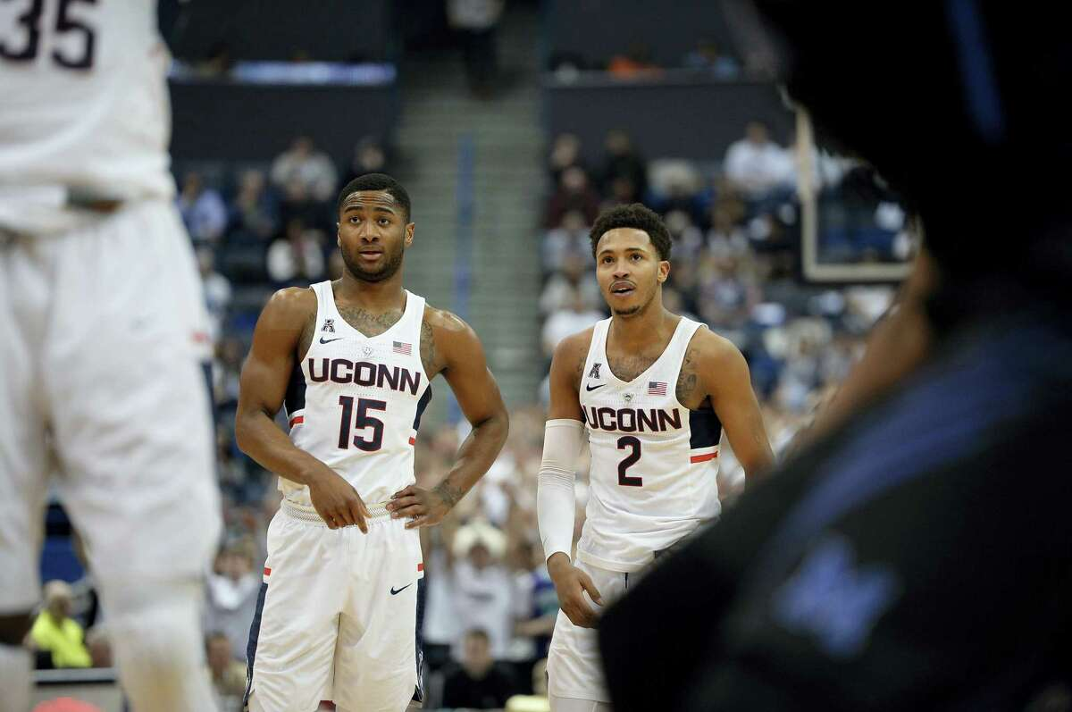UConn's Rodney Purvis, left, and Jalen Adams stand on the court during a game earlier this week.