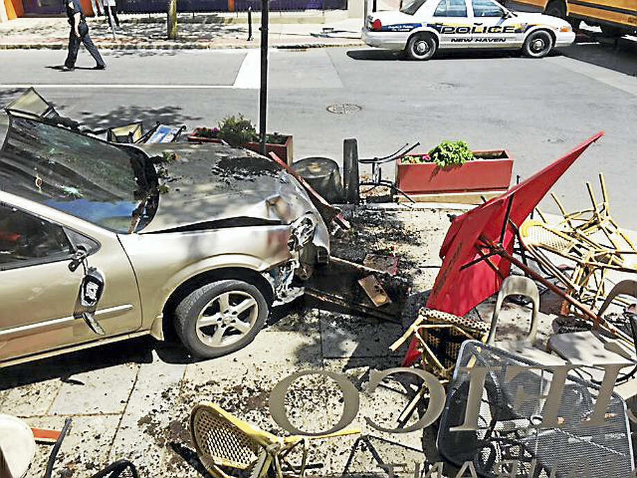 A car crashed into the outdoor seating area at Pacifico in New Haven Friday afternoon. Photo: Contributed PHOTO — Evelyn Gard