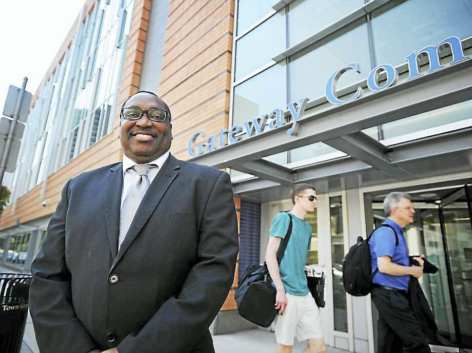 Brian A. Pounds / Hearst Connecticut MediaPaul Broadie stands outside Gateway Community College on Church Street in New Haven on June 12. Broadie is now presiding over the New Haven school along with his existing role as president of Housatonic Community College in Bridgeport Photo: Digital First Media