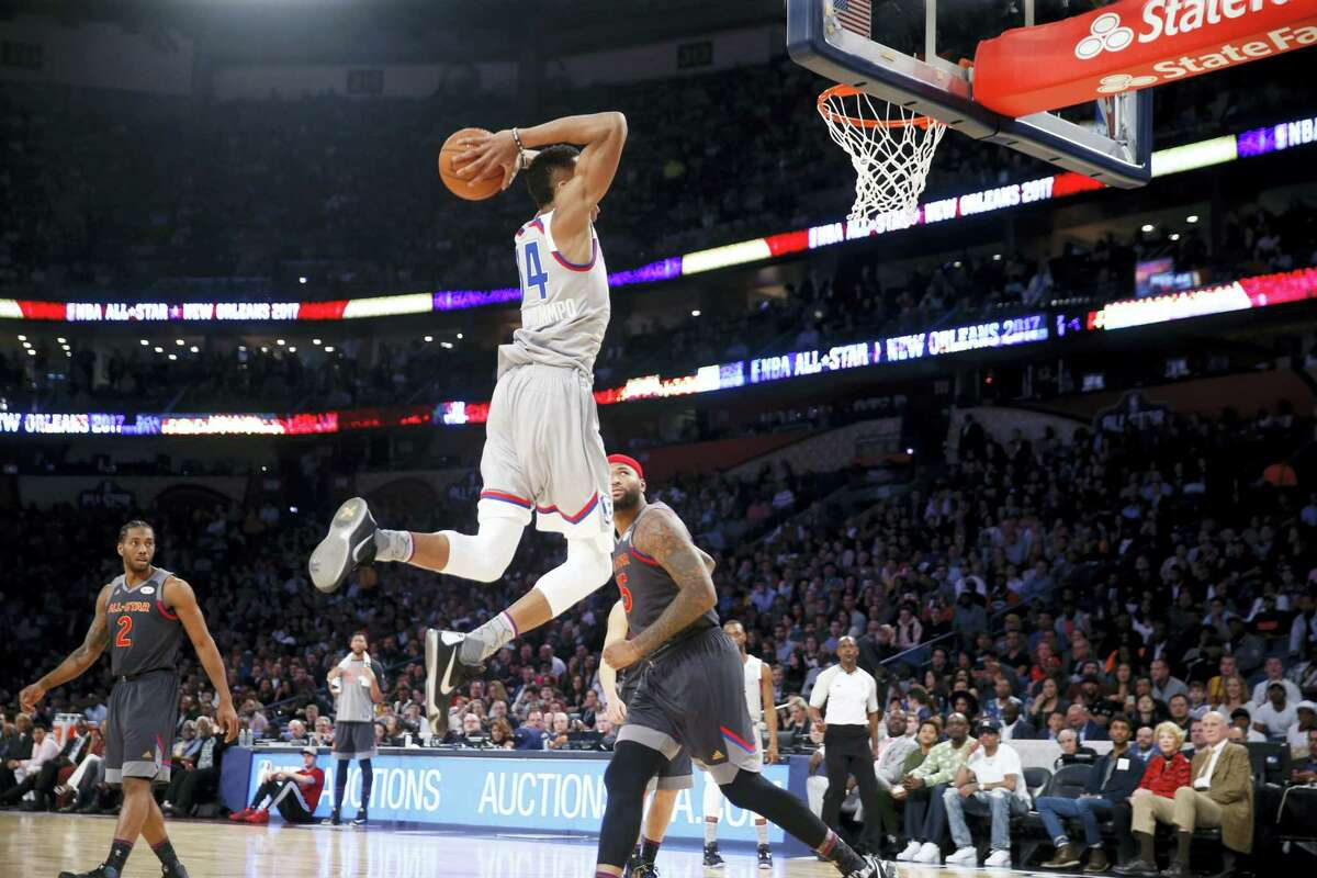 Eastern Conference small forward Giannis Antetokounmpo of the Milwaukee Bucks dunks during the first half.
