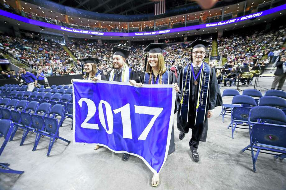 Commencement ceremonies for Southern Connecticut State University begin at the Webster Bank Arena Friday. Photo: Arnold Gold — New Haven Register