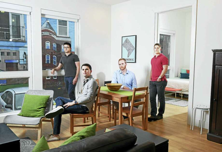 From left to right, Justin Griffis, Garrett Lance, James Arnold, and Andrew Krentz share an apartment at the Oslo, an  apartment building specifically designed to make it easier to live with roommates. Photo: Matt McClain  — Washington Post   / The Washington Post