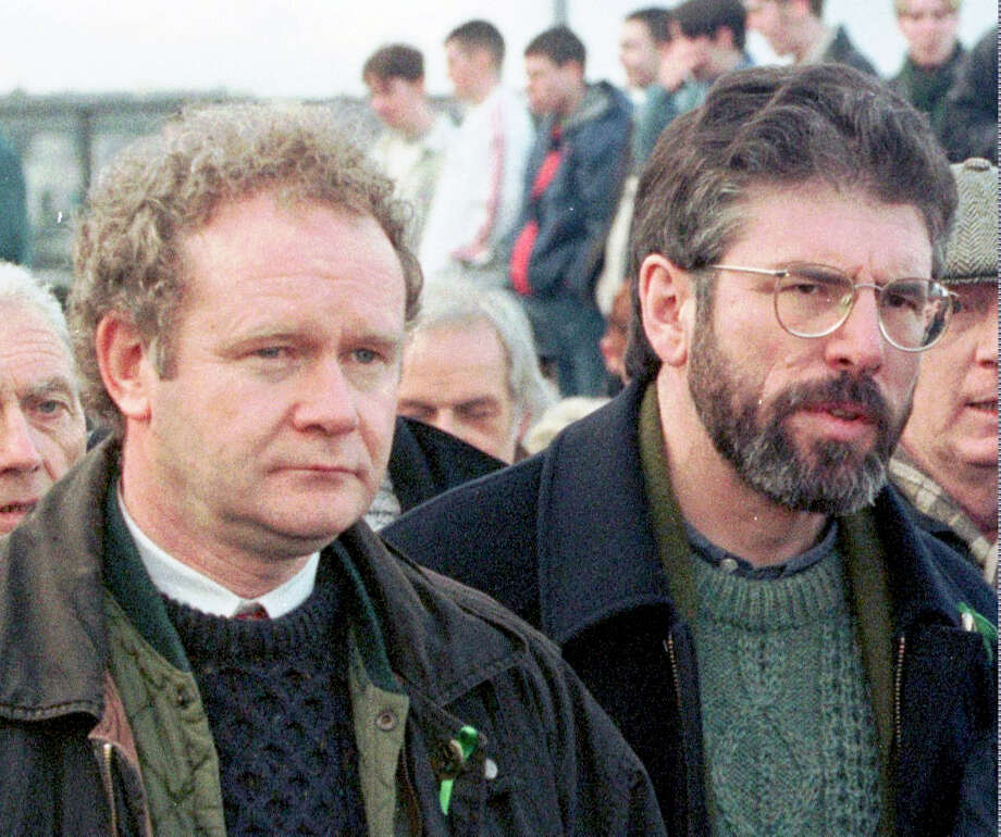 FILE - This is a Sunday, Feb. 1, 1998 file photo of Martin McGuinness, the Sinn Fein Chief Negotiator, left, and Sinn Fein's president Gerry Adams as they participate in the Bloody Sunday anniversary march in Londonderry, Northern Ireland.  McGuinness, an IRA and Sinn Fein leader who became a minister of peacetime Northern Ireland, has died, according to UK media Tuesday, March 21, 2017 . Photo: AP Photo/Paul McErlane, File / AP1998