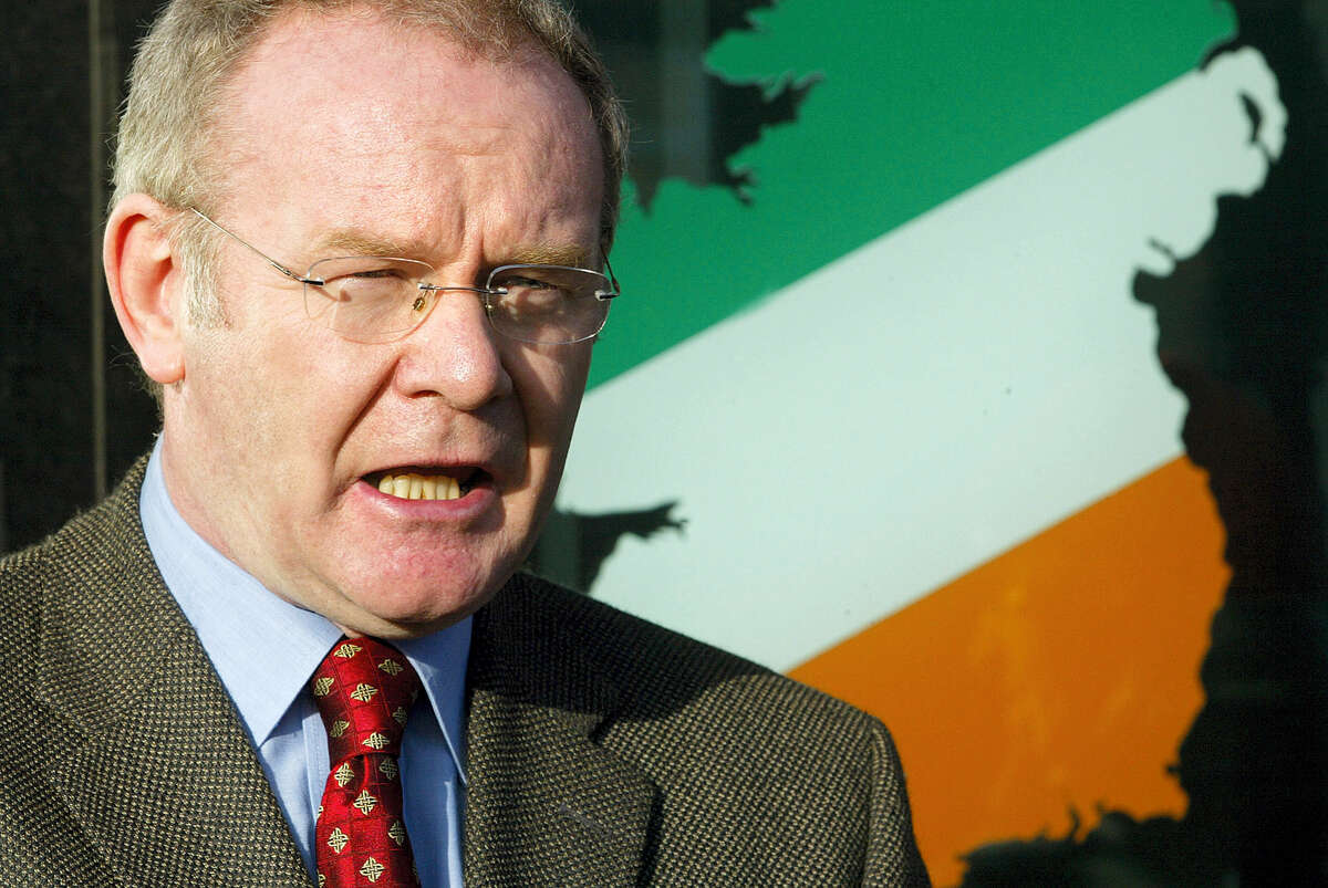 FILE - This is a Monday, Jan. 10, 2005, file photo of Sinn Fein's Martin McGuinness as he speaks to the media outside his party offices in west Belfast, Northern Ireland. McGuinness, an IRA and Sinn Fein leader who became a minister of peacetime Northern Ireland, has died, according to UK media Tuesday, March 21, 2017.