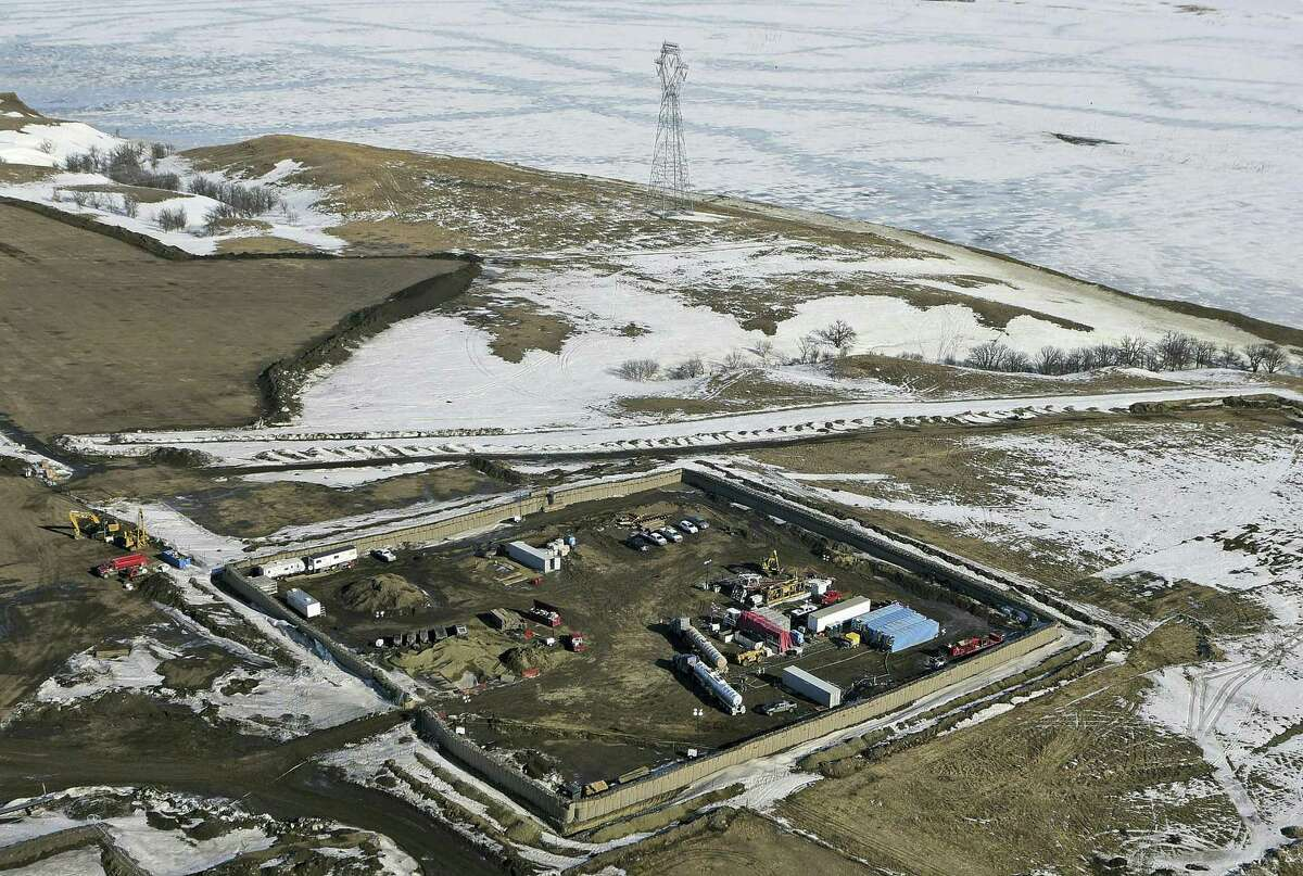 """In this Feb. 13, 2017, aerial file photo shows the site where the final phase of the Dakota Access pipeline will take place with boring equipment routing the pipeline underground and across Lake Oahe to connect with the existing pipeline in Emmons County near Cannon Ball, N.D. Environmental activists who tried to disrupt some oil pipeline operations in four states to protest the pipeline say they aren't responsible for any recent attacks on that pipeline. Dakota Access developer Energy Transfer Partners said in court documents Monday, March 20, 2017, that there have been """"coordinated physical attacks"""" along the $3.8 billion pipeline that will carry oil from North Dakota to Illinois."""