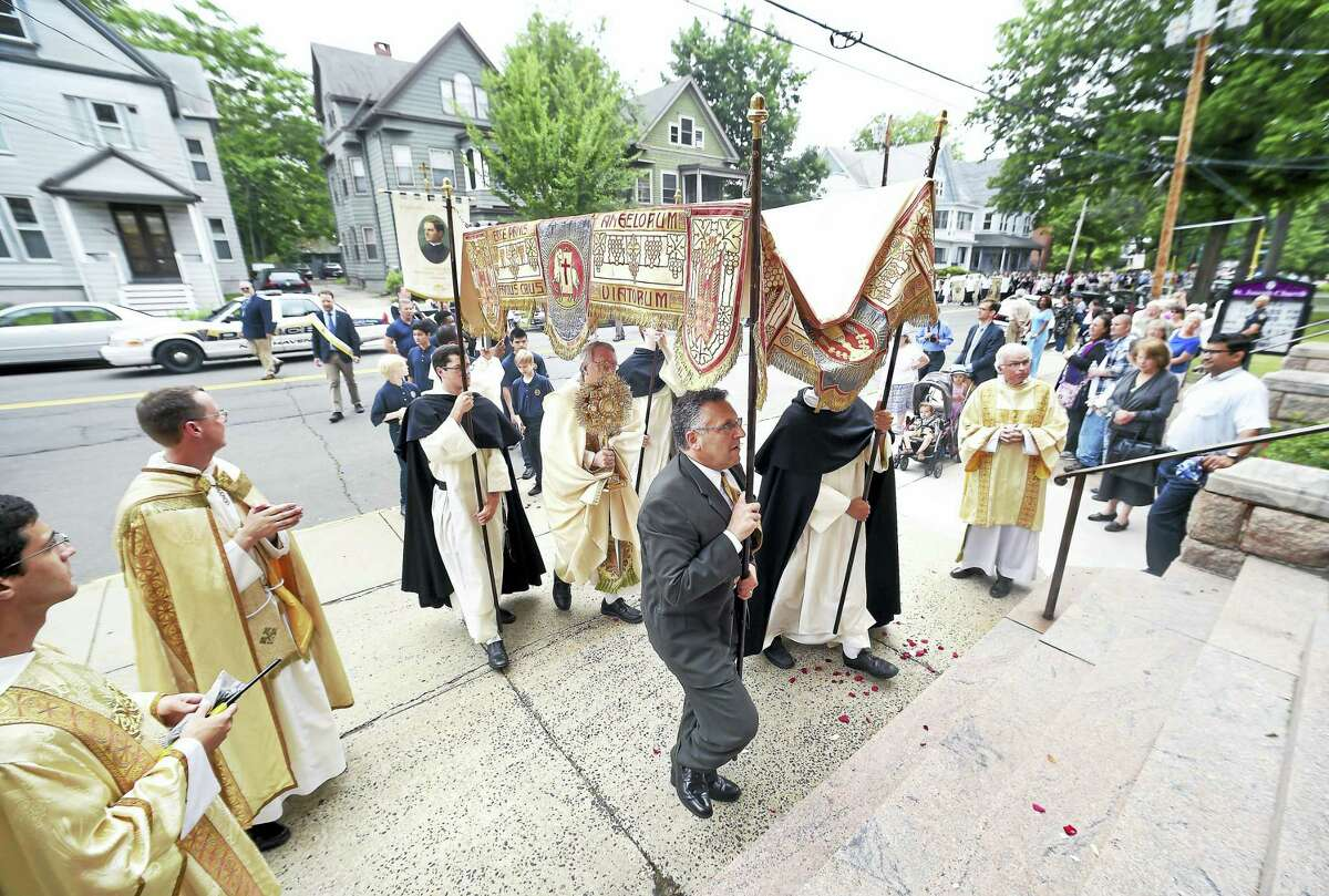 Arnold Gold / Hearst Connecticut Media The procession enters St. Joseph's Church in New Haven for a benediction and picnic.
