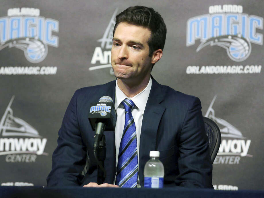 In this Feb. 5, 2015 photo, Orlando Magic general manager Rob Hennigan pauses to answer a question during a news conference in Orlando, Fla. The Orlando Magic have fired general manager Rob Hennigan after missing the postseason for five straight seasons. The team confirmed the dismissal on April 13, 2017. Photo: Stephen M. Dowell — Orlando Sentinel Via AP, File   / Orlando Sentinel