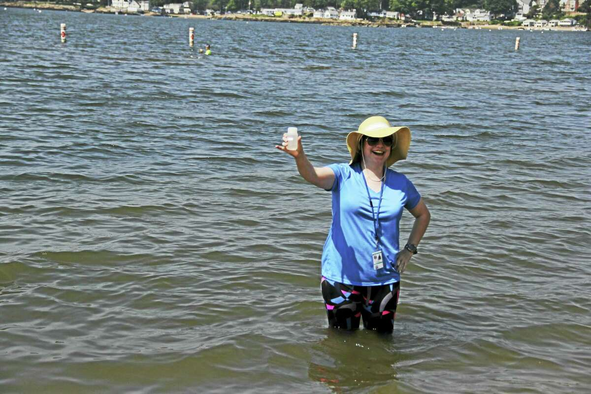 Anna Bisaro / Hearst Connecticut Media Kellynn Reese collects water samples at public bathing waters in Branford, North Branford, and East Haven every week so the water can be tested for harmful bacteria.