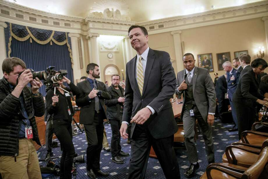 FBI Director James Comey takes a break after three hours of testifying on Capitol Hill in Washington Monday. Photo: J. SCOTT APPLEWHITE — THE ASSOCIATED PRESS   / AP