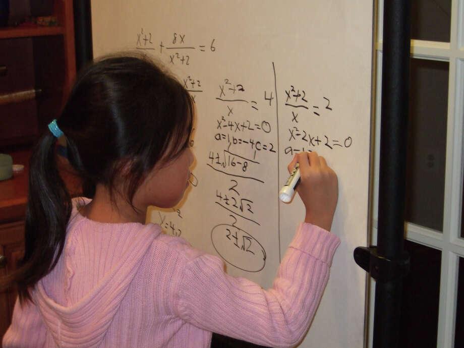 Stephanie Mui doing algebra in first grade. Photo: Family Photo Courtesy Of Stephanie Mui   / Family photo courtesy of Stephanie Mui