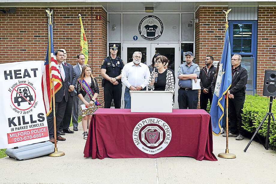 Contributed photo  From left front are Connecticut Kid Governor Jessica Brocksom, State Rep. Charlie Ferraro, R-117, and State Rep. Pam Staneski, R-119, who held an informational press conference recently regarding their 'Heat Kills' campaign to keep animals and children safe. Milford Mayor Ben Blake is standing next to the flag and behing Jessica. Photo: Digital First Media