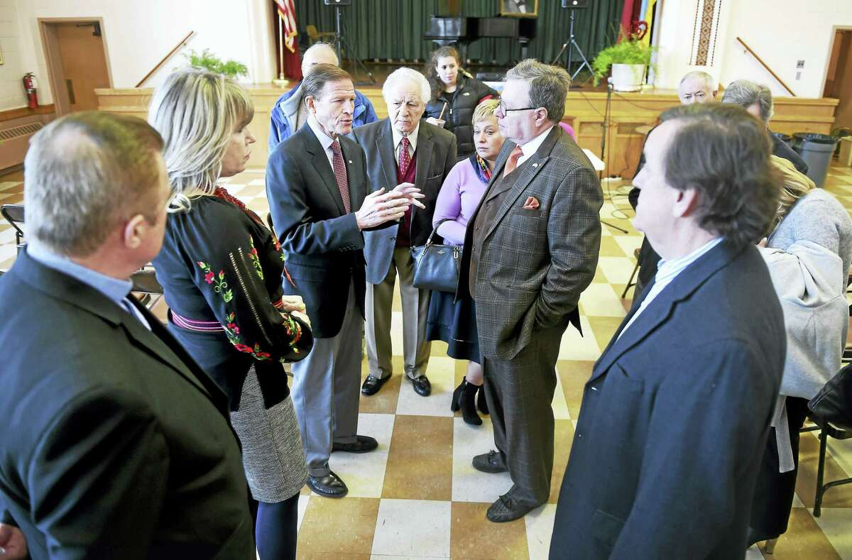 U.S. Sen. Richard Blumenthal, center, speaks with members of St. Michael's Church in New Haven about Russian aggression in Ukraine.