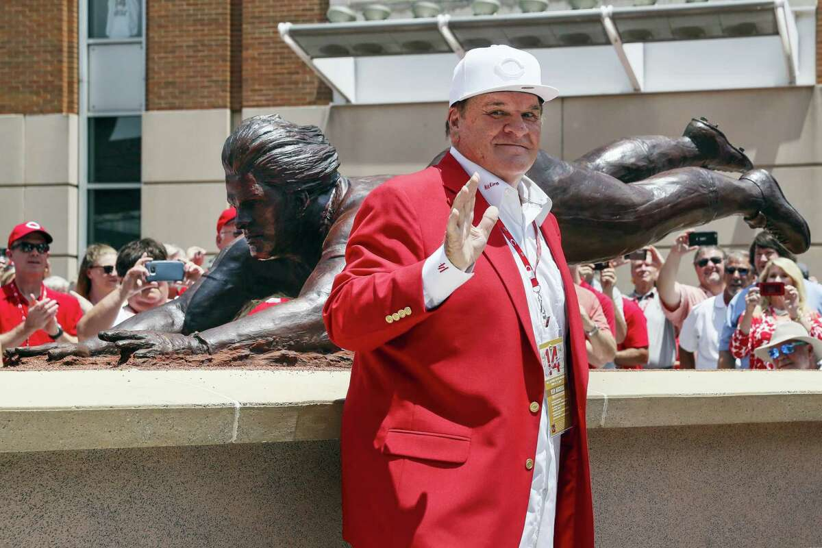 Former Cincinnati Reds player Pete Rose smiles as he stands for pictures during the dedication of his statue outside Great American Ballpark Saturday in Cincinnati.