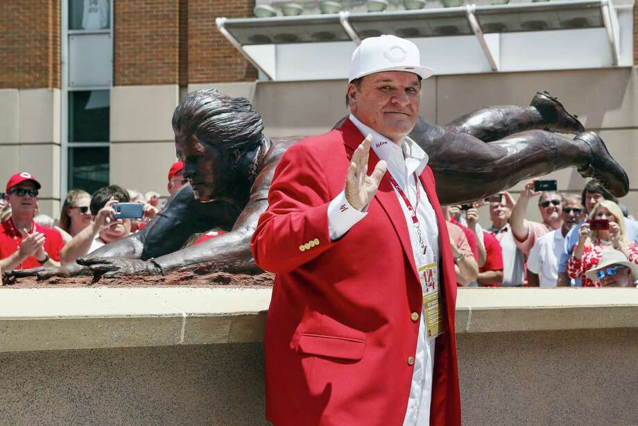 Former Cincinnati Reds player Pete Rose smiles as he stands for pictures during the dedication of his statue outside Great American Ballpark Saturday in Cincinnati. Photo: John Minchillo — The Associated Press   / AP