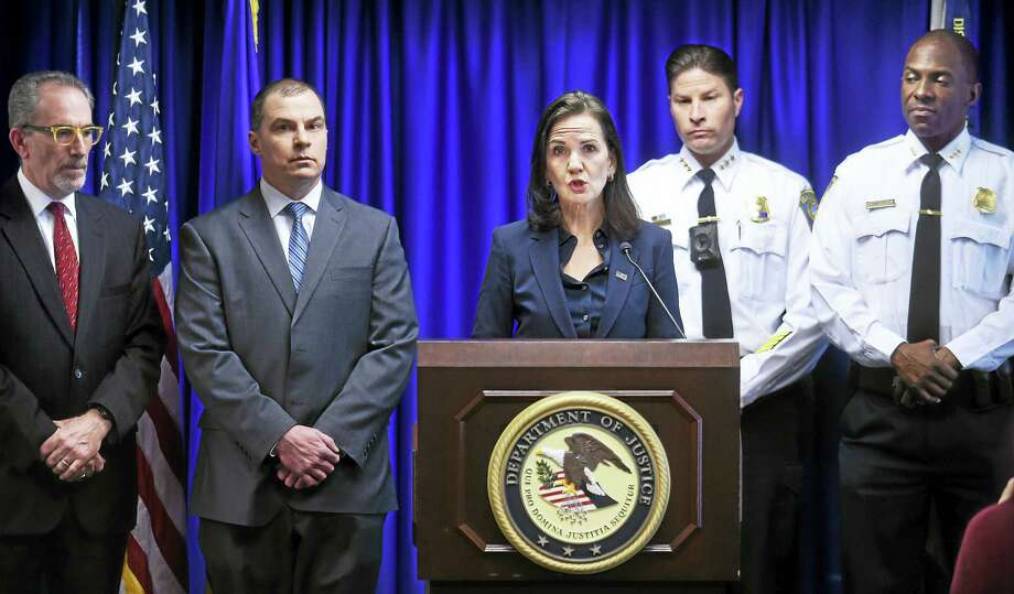 U.S. Attorney Deirdre Daly, center, announces the culmination of a multi-year joint investigation of the Red Side Guerilla Brims. From left are Assistant U.S. Attorney Peter Markle, ATF Resident Agent in Charge Mike Zeppieri, Daly, Hamden Police Chief Thomas Wydra and New Haven Acting Police Chief Anthony Campbell. Photo: Arnold Gold — New Haven Register