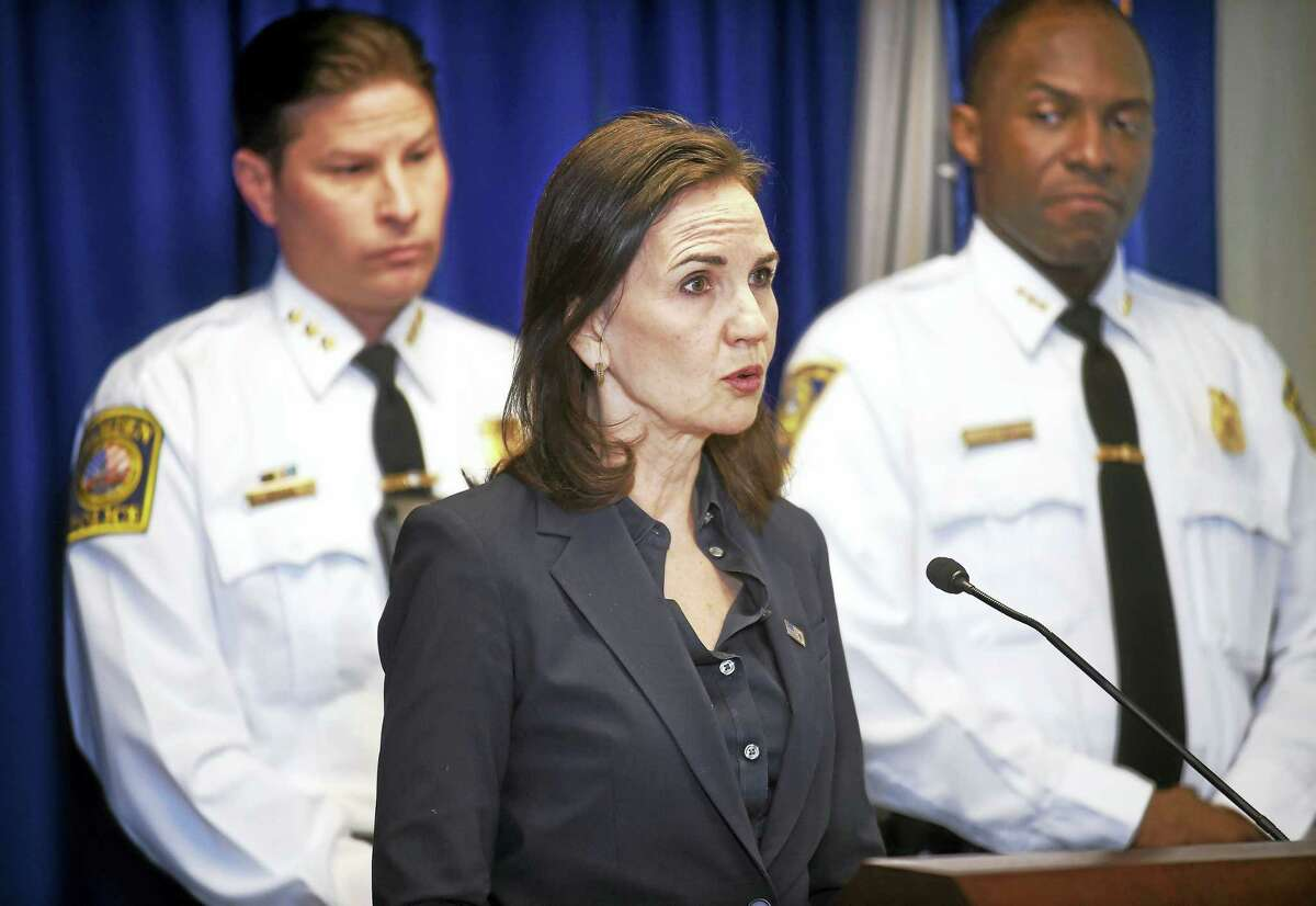 U.S. Attorney Deirdre Daly, center, announces the culmination of a multi-year joint investigation of the Red Side Guerilla Brims. From left are Hamden Police Chief Thomas Wydra, Daly, and New Haven Acting Police Chief Anthony Campbell.