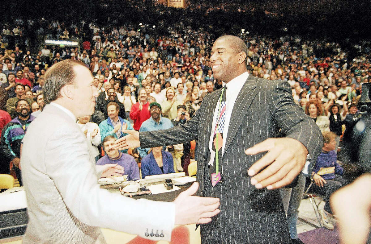 Magic Johnson, during his brief stint as Lakers coach, greets his former coach Mike Dunleavy Sr., who was coaching the Bucks in 1994.