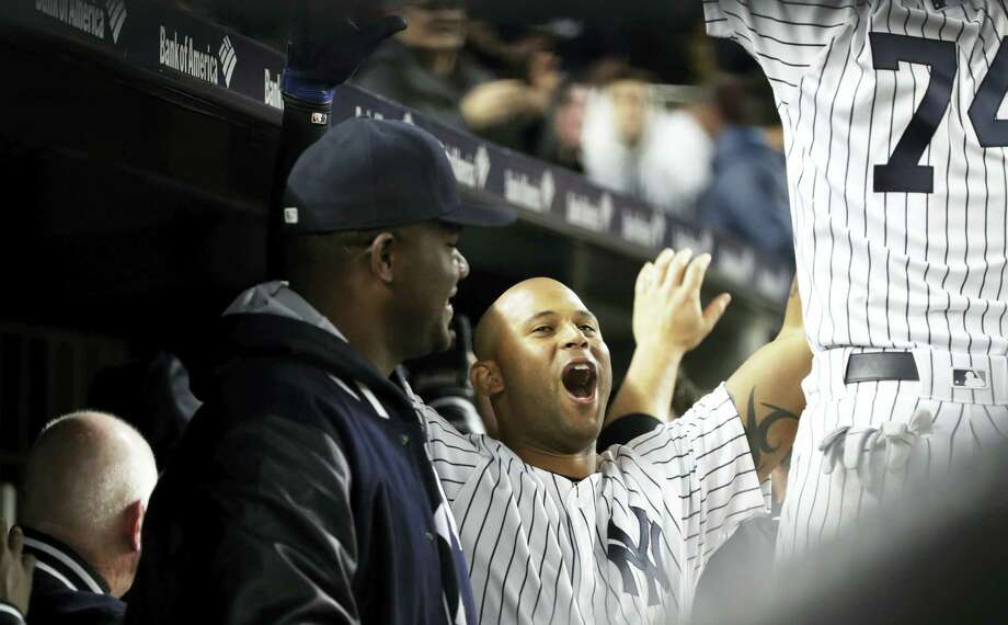 The Yankees' Aaron Hicks celebrates with teammates after hitting a two-run home run during the seventh inning against the Rays on Thursday. Photo: Frank Franklin II — The Associated Press   / Copyright 2017 The Associated Press. All rights reserved.