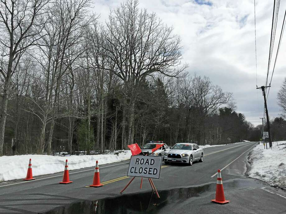 Route 72 in Harwinton was closed at the intersection with Locust Road while police investigated a dead body found at a reservoir. Photo: Ben Lambert — The Register Citizen