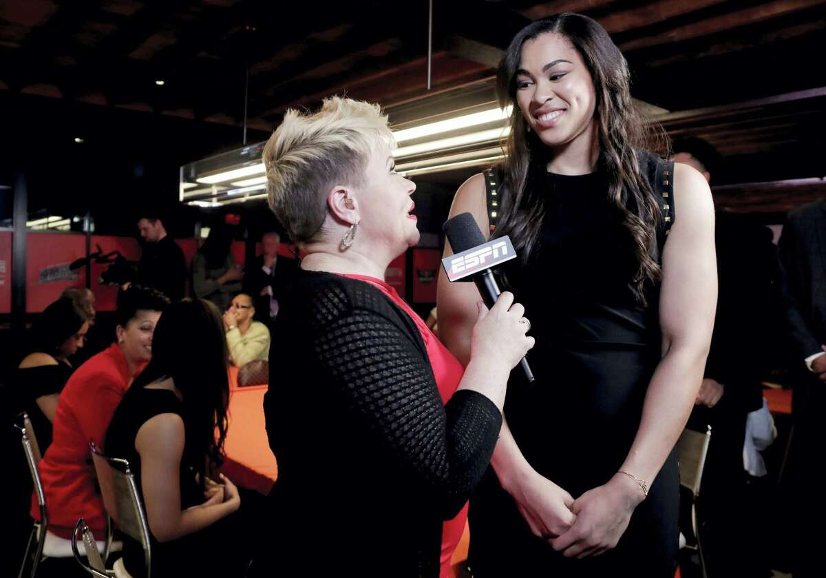 Brionna Jones, right, reacts during an interview at Thursday's WNBA draft.
