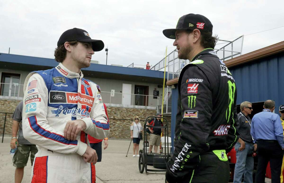 Ryan Blaney, left, talks with Kurt Busch before a practice session Saturday in Brooklyn, Mich.