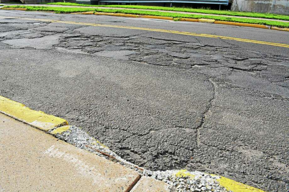 Pot holes in East Hampton in this file photo. Photo: Middletown Press File Photo