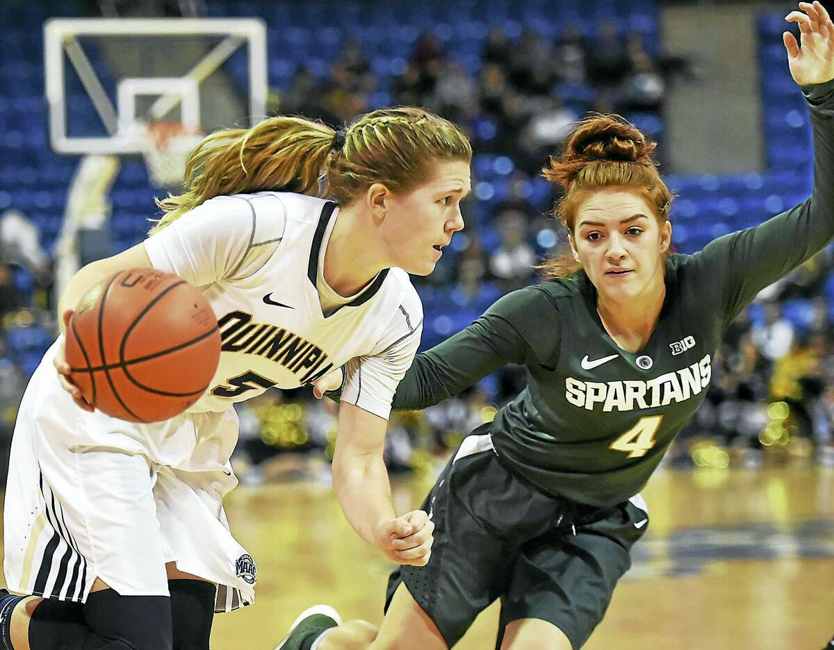 Quinnipiac junior guard Carly Fabbri drives to the paint as Michigan State freshman guard Taryn McCutchon defends, in a 71-54 win for the Spartans in a non-conference game December 6, 2016 at the TD Bank North Sports Center at Quinnipiac University in Hamden.
