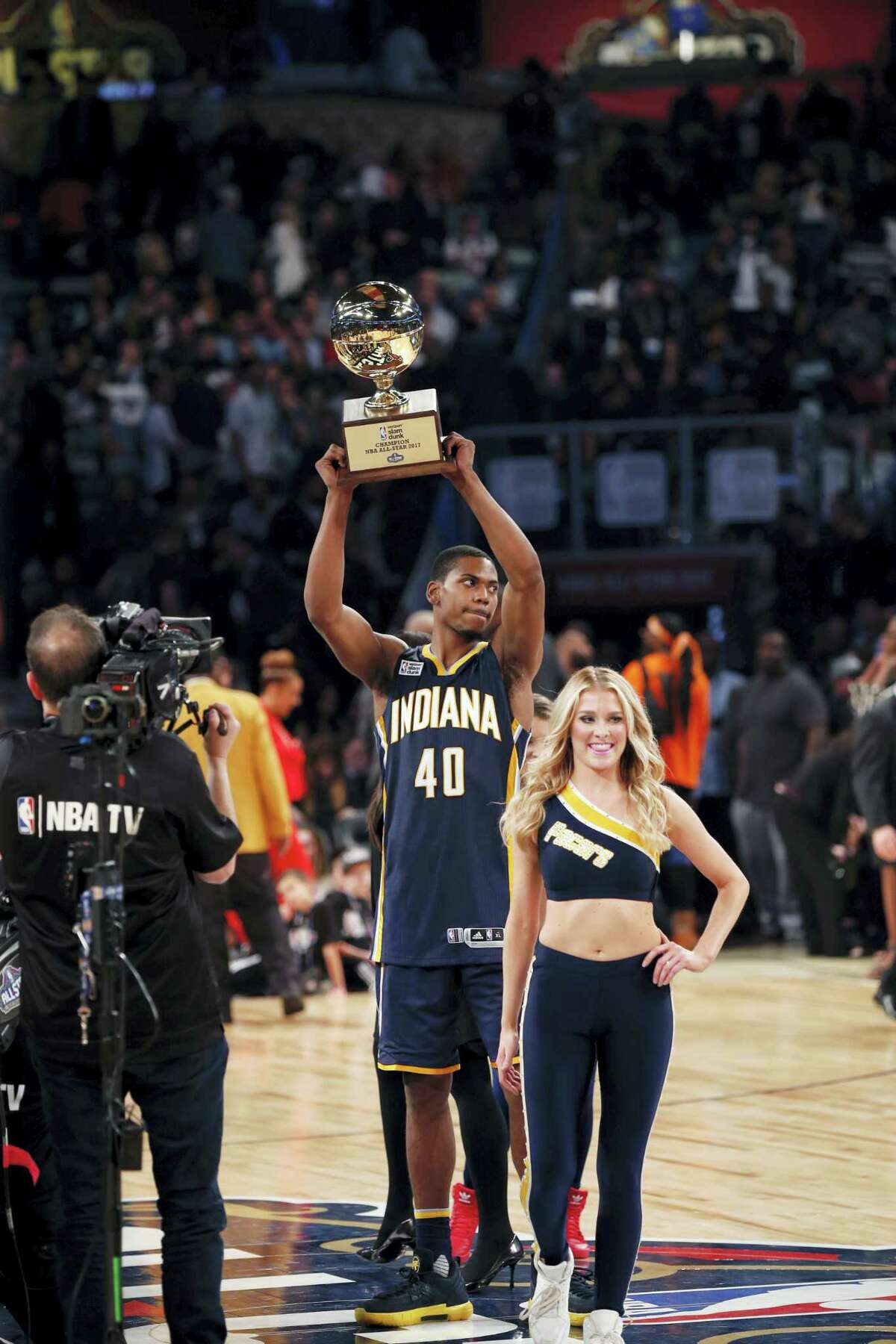 Indiana pacers Glenn Robinson III holds up his trophy after winning the slam dunk contest during NBA All-Star Saturday Night events in New Orleans, Saturday, Feb. 18, 2017. (AP Photo/Gerald Herbert)
