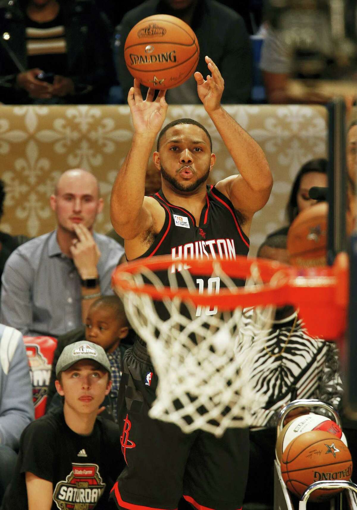 Houston Rockets guard Eric Gordon shoots during the All-Star 3-point shootout on Saturday.