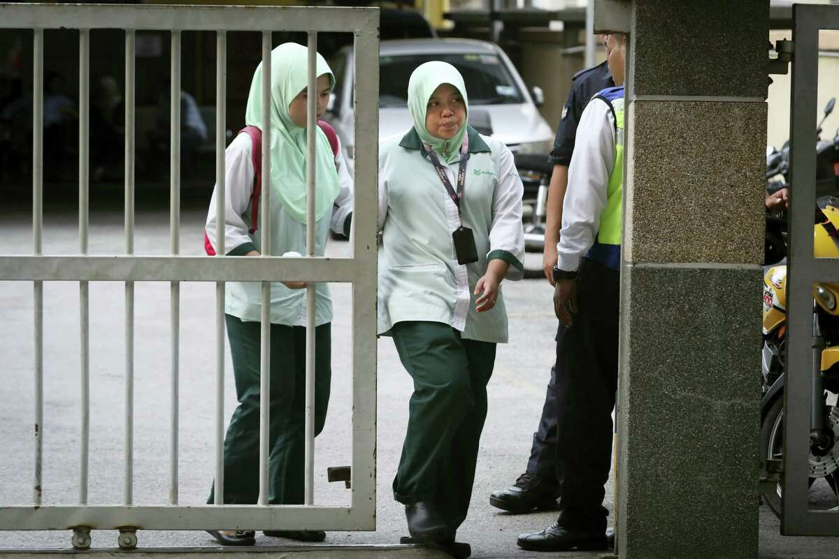 Medical staff leave the forensic department at Kuala Lumpur Hospital in Kuala Lumpur, Malaysia, Saturday, Feb. 18, 2017. Malaysian authorities announced two more arrests Thursday in the death of the North Korean leader's half brother, Kim Jong Nam, whose apparent assassination this week unleashed a wave of speculation and intrigue: a pair of female assailants, a broad-daylight killing and a dictator-sibling out for blood.
