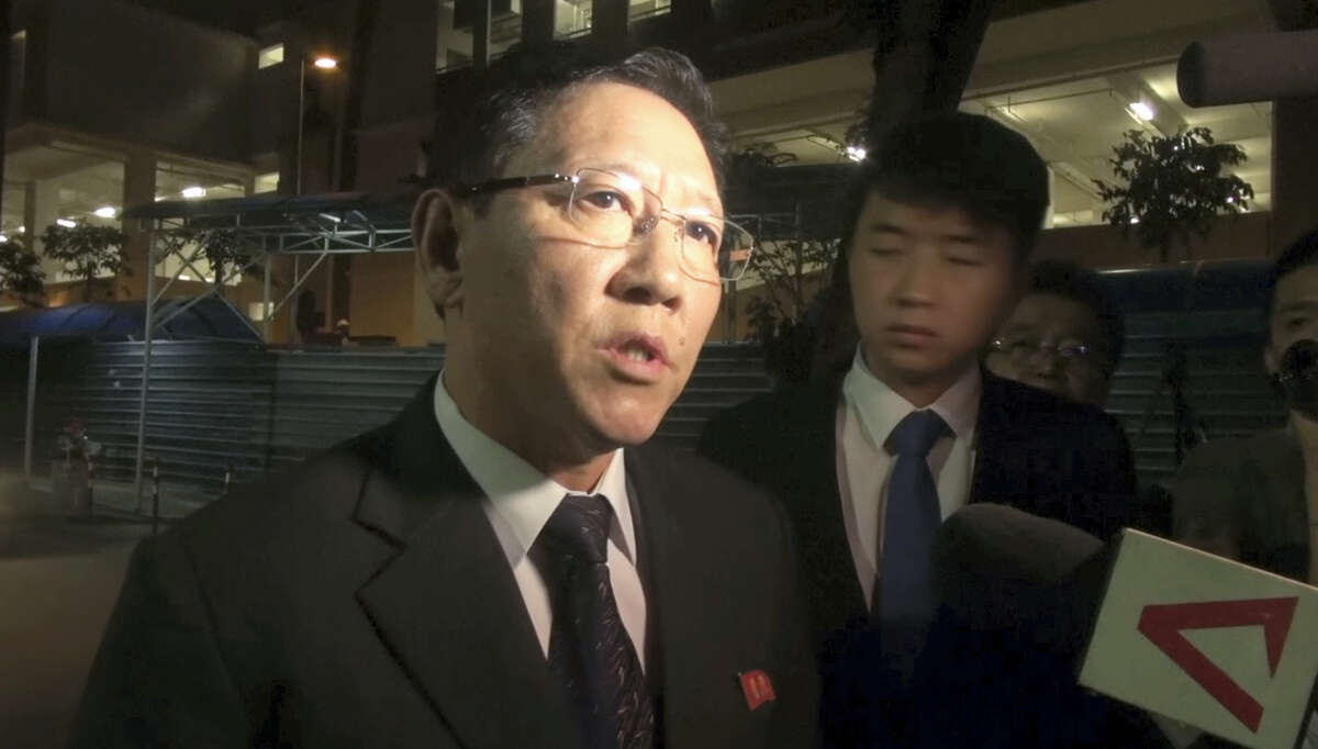"""In this image made from video, North Korean Ambassador to Malaysia Kang Chol speaks to the media gathered outside the morgue in Kuala Lumpur, Malaysia, Friday, Feb. 17, 2017. North Korea said it will reject the results of an autopsy on its leader's estranged half brother, the victim of an apparent assassination this week at an airport in Malaysia. Kang said Malaysian officials may be """"trying to conceal something"""" and """"colluding with hostile forces."""""""