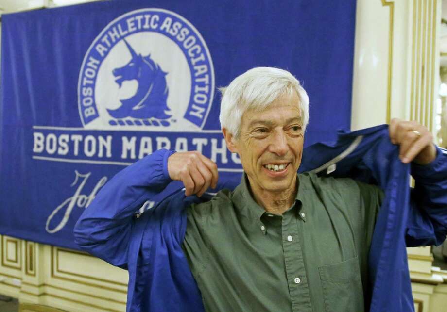 Ben Beach dons a Boston Marathon jacket before a media availability begins at the Copley Plaza Hotel near the Boston Marathon finish line Thursday in Boston. Beach is on the verge of becoming the first person to run the Boston Marathon 50 consecutive times if he completes the race Monday. Photo: Stephan Savoia — The Associated Press   / Copyright 2017 The Associated Press. All rights reserved.