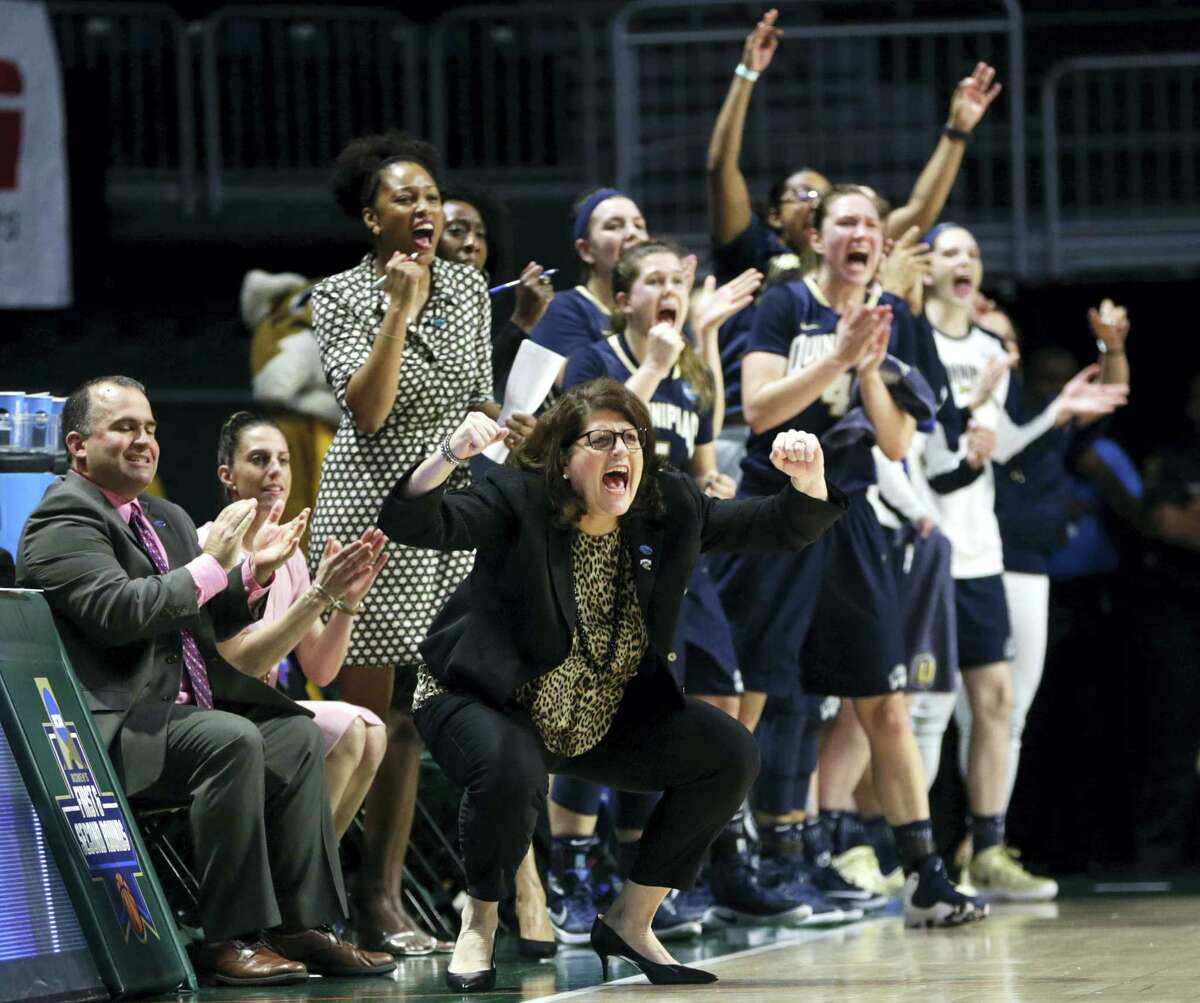 Quinnipiac head coach Tricia Fabbri, left, shouts during the first half of Monday's NCAA Tournament second-round game against Miami in Coral Gables, Fla.