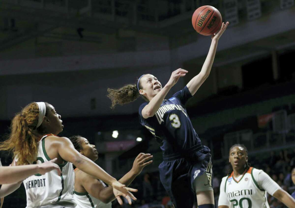 Quinnipiac's Adily Martucci (3) drives to the basket over Miami's Erykah Davenport.