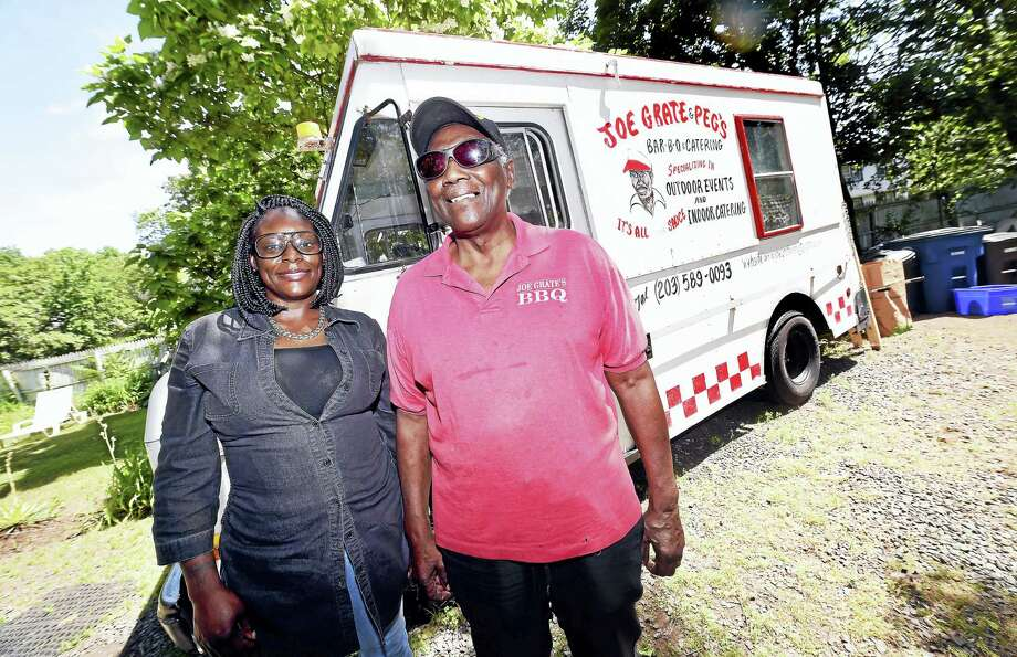 Melissa  Singleton is photographed with Joe Grate in front of his food truck at his home in New Haven.  The corner of Orchard and Munson streets in New Haven will be named in his honor on June 24 as the result of a petition drive by Singleton. Photo: Arnold Gold/Hearst Connecticut Media
