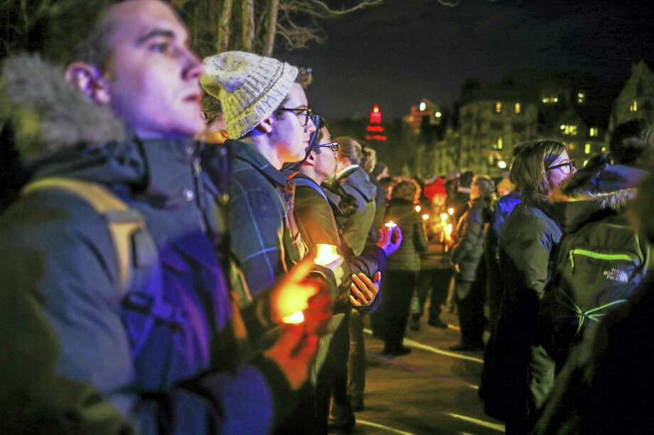 A gathering and vigil held at Yale University in support of refugees and immigrants. Photo: Derek-Jon Flagge