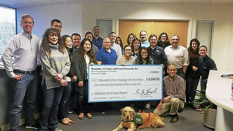 """DENIM DO-GOODERS: Dworken, Hillman, LaMorte and Sterczala, P.C., specializing in accounting, tax, auditing and business consulting, with offices in Shelton, has selected Educated Canines Assisting with Disabilities as its 2016 Jeans for Charity recipient, raising $5,500. The Jeans for Charity program encourages employees to donate money weekly to a fund that is matched by the firm, in exchange for allowing participants to wear jeans on Fridays, according to a release. Since its beginning in 2014, the program has donated more than $48,900 to local charities, the release said. ECAD's mission is to provide highly skilled service dogs to people with disabilities. For information, visit <a href=""""http://www.ecad1.org"""">www.ecad1.org</a>. Photo: CONTRIBUTED PHOTO"""