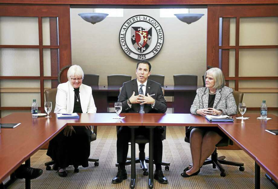 Marc Camille (center), the incoming president of Albertus Magnus College, is introduced to media at Walsh Hall on Monday. Next to Camille are Sister Patricia Twohill (left), Prioress of the Dominican Sisters of Peace, and Jeanne Dennison, Chair of the Board of Trustees of Albertus Magnus College and Chair of the Search Committee. Photo: Arnold Gold-New Haven Register