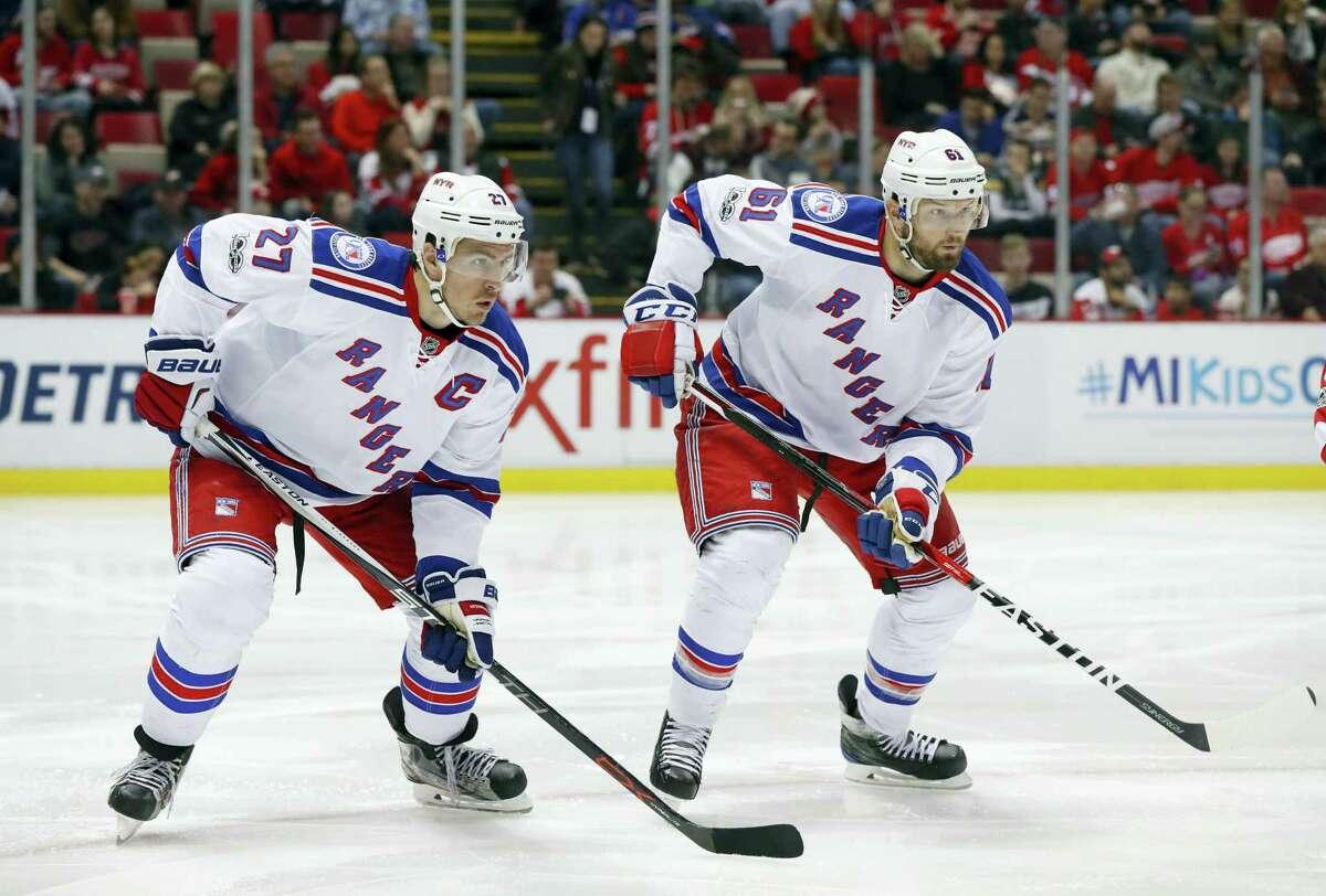 Rangers defenseman Ryan McDonagh (27) and Rick Nash (61).
