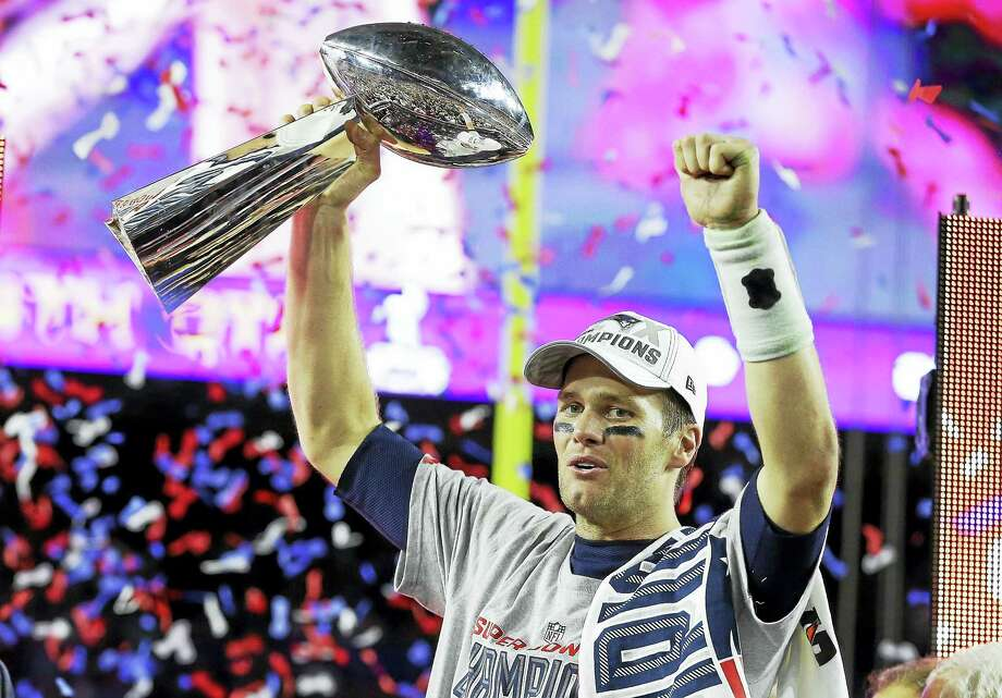 Patriots quarterback Tom Brady celebrates with the Vince Lombardi Trophy after winning Super Bowl XLIX against the Seattle Seahawks. Photo: The Associated Press File Photo   / AP