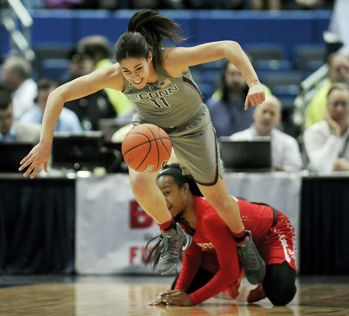 UConn's Kia Nurse, top, breaks away from Houston's Mariah Mitchell during Saturday's game in Hartford.