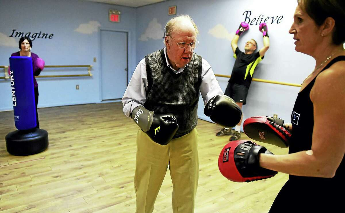 Cynthia Criscuolo of East Haven,Thomas Black of Guilford, and Paul Scott of Guilford with Michelle Hespeler, founder and director of Beat Parkinson's Today helping as an instructor, left to right, train during a Beat Parkinson's Today boxing class at Studio One in Branford. The class is for all ages and stages of the disease. The boxing helps ease the physical symptoms of Parkinson's using functional interval training techniques.