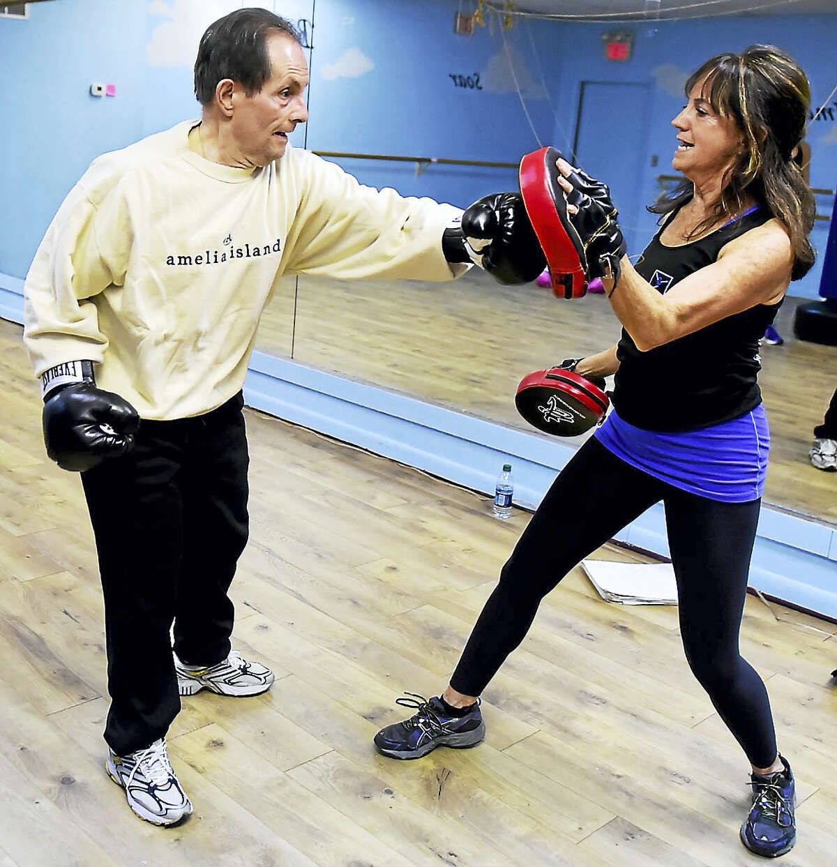 (Peter Hvizdak - New Haven Register) Fred Annunziata of Branford, left, trains with Terry O'Hara, Director of Personnel and Personal Trainer of Beat Parkinson's Today during a Beat Parkinson's Today boxing class at Studio One in Branford Wednesday, February 1, 2017. The class is for all ages and stages of the disease. The boxing helps ease the physical symptoms of Parkinson's using functional interval training techniques.