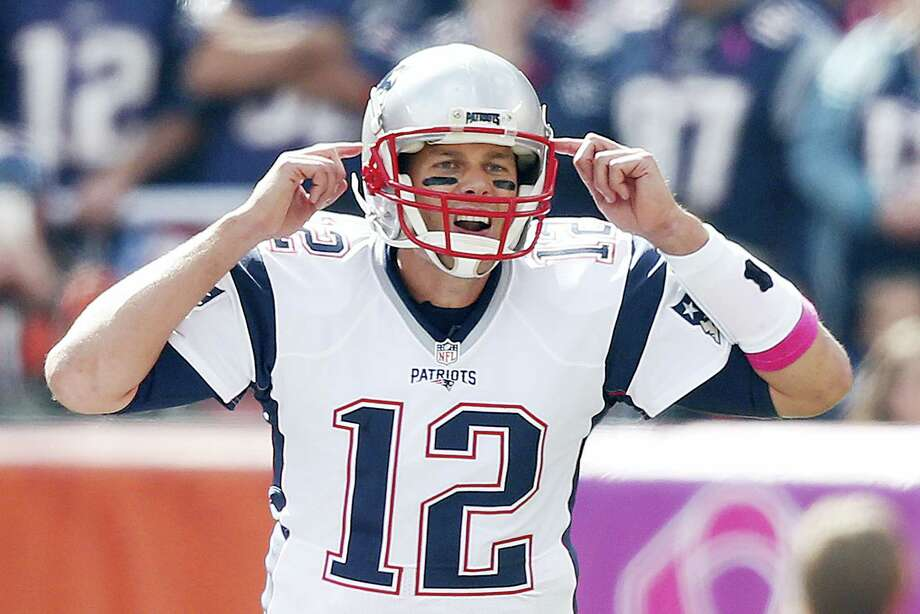 Patriots quarterback Tom Brady gestures during a game earlier this season. Photo: The Associated Press File Photo   / FR78273 AP