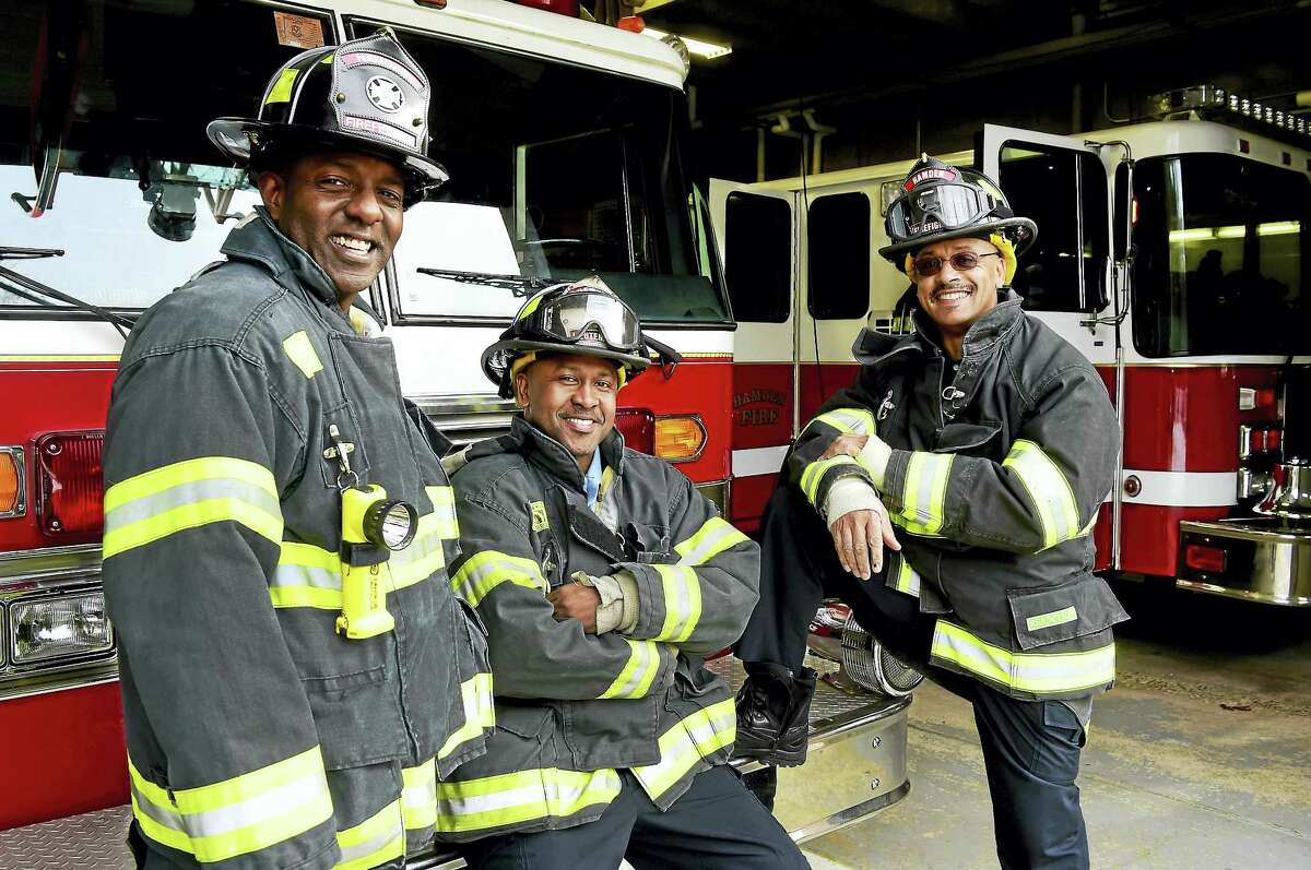Firefighter/EMT Victor Jackson, Fire Lieutenant/EMT Julio Lopes, and Firefighter/EMT Sayyid Abdur-Rahman of the Hamden Fire Department, left to right, are planning to start a Fire Explorers Academy to encourage youth to consider firefighting as a career path.