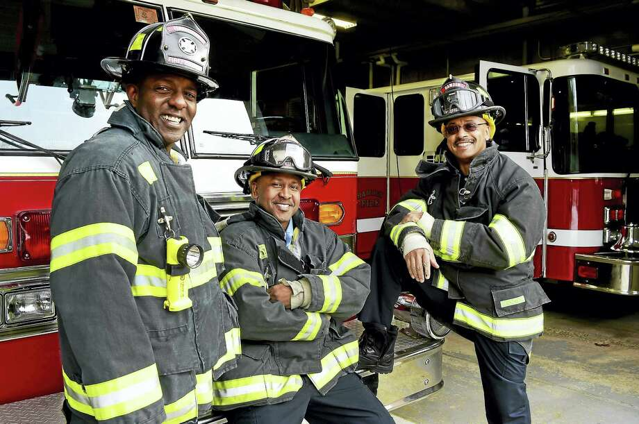 Firefighter/EMT Victor Jackson, Fire Lieutenant/EMT Julio Lopes, and Firefighter/EMT Sayyid Abdur-Rahman of the Hamden Fire Department, left to right, are planning to start a Fire Explorers Academy to encourage youth to consider firefighting as a career path. Photo: Peter Hvizdak — New Haven Register   / ©2017 Peter Hvizdak